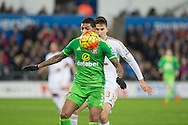 Patrick van Aanholt of Sunderland tracked by Federico Fernandez of Swansea during the Barclays Premier League match between Swansea City and Sunderland at the Liberty Stadium, Swansea, Wales on 13 January 2016. Photo by Mark Hawkins.