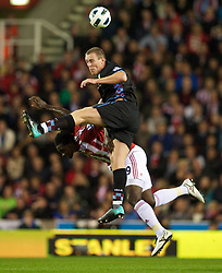 STOKE, ENGLAND - Monday, September 13, 2010: Aston Villa's Richard Dunne and Stoke City's Kenwyne Jones during the Premiership match at the Britannia Stadium. (Photo by David Rawcliffe/Propaganda)