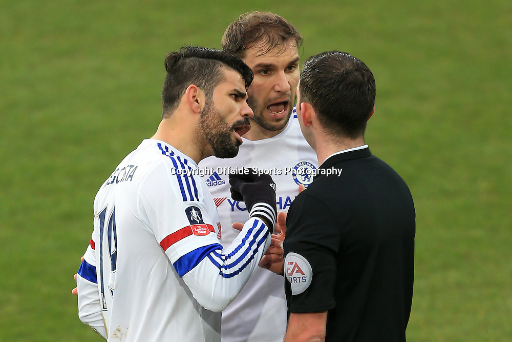 12th March 2016 - FA Cup - Quarter-Final - Everton v Chelsea - Diego Costa of Chelsea (L) and teammate Branislav Ivanovic confront referee Michael Oliver - Photo: Simon Stacpoole / Offside.