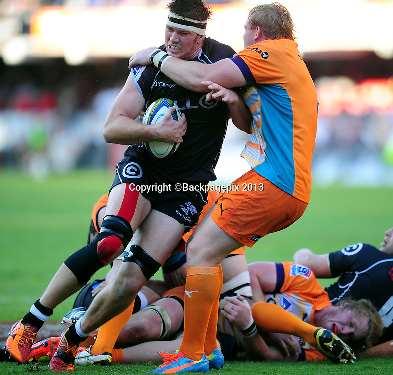 Stephen Lewies of the Sharks tackled by Adriaan Strauss of the Cheetahs during the 2014 Super Rugby Sharks match between Sharks and Cheetahs at the Kings Parks Stadium in Durban , Kwa-Zulu Natal on the 19th of April 2014<br /> <br /> &copy;Sabelo Mngoma/BackpagePix
