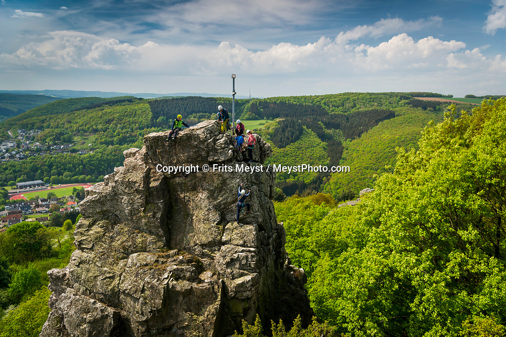 Kirn, Nahetal, Germany, May 2018. Kirner Dolomiten - Kirn Dolomites - suggests a rocky mountain range with much climbing potential. However, they rather  are large rocks sticking out of the green forested landscape. The Nahe region is named after the river that traverses the valleys of the forested Hunsrück Hills as it flows towards the Rhine. A landscape of vineyards, orchards and meadows interspersed with cliffs and striking geological formations. Photo by Frits Meyst / MeystPhoto.com