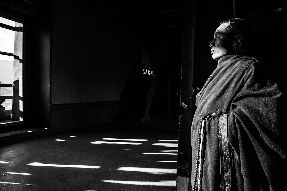 A monk holds still in Bhutan