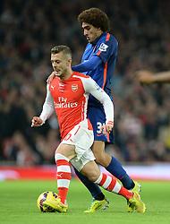 Manchester United's Marouane Fellaini puts pressure on Arsenal's Jack Wilshere - Photo mandatory by-line: Alex James/JMP - Mobile: 07966 386802 - 22/11/2014 - Sport - Football - London - Emirates Stadium - Arsenal v Manchester United - Barclays Premier League