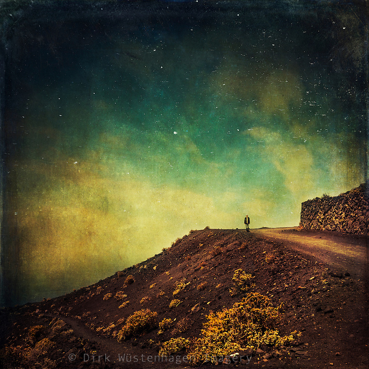 Hiker in the volcanic surrounding of the south of La Palma/Canary Islands/Spain - texturized photograph