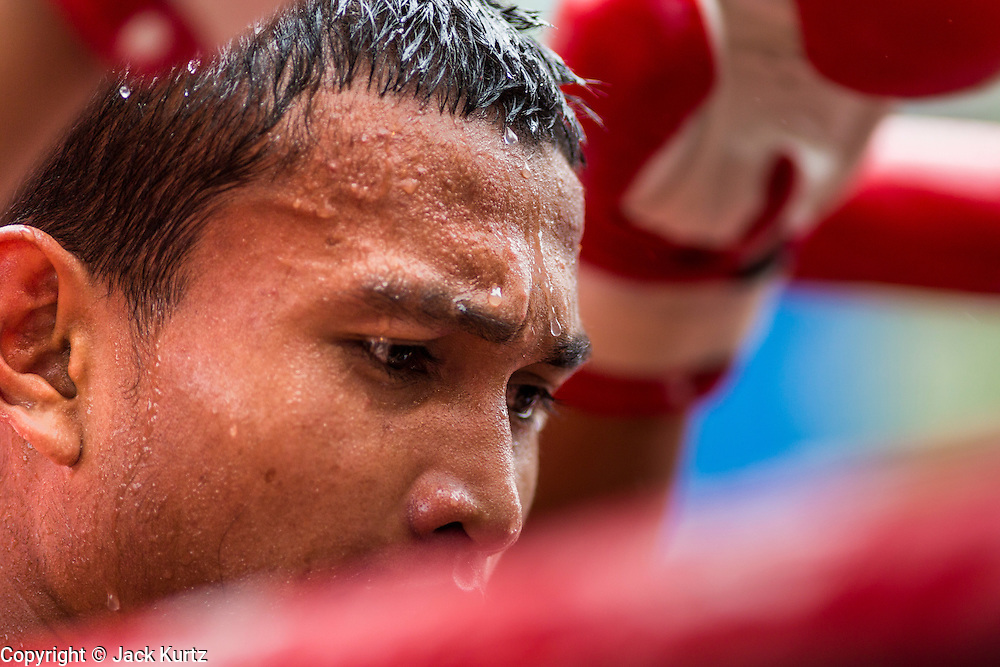 28 JULY 2013 - BANGKOK, THAILAND: A boxer between rounds during the ASEAN Muay Thai Championship at MBK shopping center in Bangkok.      PHOTO BY JACK KURTZ