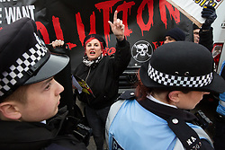 London, UK. 12th January, 2019. Lisa Mckenzie of Class War protests against the 'Britain is Broken: General Election Now' demonstration organised by the People's Assembly Against Austerity on the basis that neither the left-wing or right-wing yellow vests in the UK are equivalent to the 'gilets jaunes' in France and that a revolution and not a general election is required in order to solve the problems of the working class in the UK.