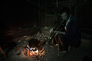 Yang Tian Mei, 47 years old grand father smoking tobacco through a water pipe. after dinner at night.