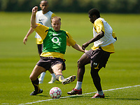 Photo: Richard Lane.<br />Arsenal Training Session. The Barclays Premiership. 11/05/2006.<br />Dennis Bergkamp battles with Kolo Toure during a training session ahead of next weeks Champions League final.