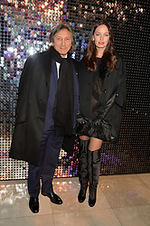 LEON MAX and YANA BOYKO at a private view of Isabella Blow: Fashion Galore! held at Somerset House, London on 19th November 2013.