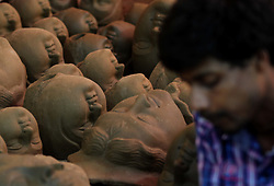 September 11, 2017 - Bhubaneswar, India - A traditional image maker or artist is busy to polish a clay portraits of goddess Durga ahead of the Durga puja festival in the eastern Indian state Odisha's capital city Bhubaneswar, on September 11, 2017. (Credit Image: © Str/NurPhoto via ZUMA Press)