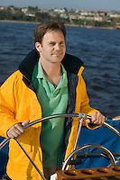 Man at Helm of Sailboat