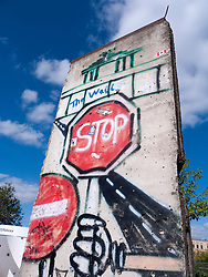 Section of original Berlin Wall with graffiti in Berlin Germany
