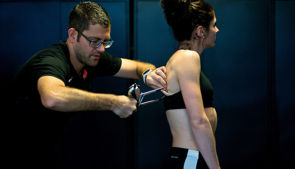Trent Stellingwerff, applied sport physiologist with a specialization in performance nutrition performs anthropometric measurements on Kate Van Buskirk at the Pacific Institute for Sport Excellence on December 3rd 2015 in Victoria, British Columbia Canada.