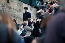 Parisians look on Notre Dame Cathedral after a giant fire left the iconic monument heavily damaged. French President Emmanuel Macron vowed to rebuild the 13th century building that welcomes tens of millions of worshippers and tourists per year. Paris, France, April 16, 2019. Photo by Ania Freindorf/ABACAPRESS.COM
