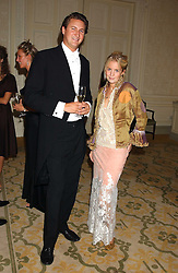 MR ALEX FIELD and MISS MARISSA MONTGOMERY at a dinner hosed by Moet & Chandon at their headquarters at 13 Grosvenor Crescent, London on 12th October 2005.<br /><br />NON EXCLUSIVE - WORLD RIGHTS
