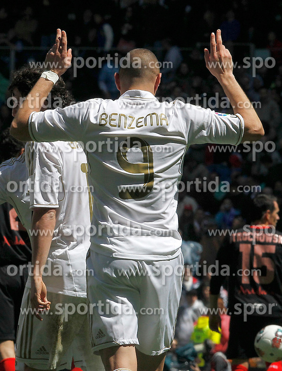 29.04.2012, Santiago Bernabeu Stadion, Madrid, ESP, Primera Division, Real Madrid vs FC Sevilla, 36. Spieltag, im Bild Real Madrid's Karim Benzema celebrates the football match of spanish 'primera divison' league, 36th round, between Real Madrid and FC Sevilla at Santiago Bernabeu stadium, Madrid, Spain on 2012/04/29. EXPA Pictures © 2012, PhotoCredit: EXPA/ Alterphotos/ ATTENTION - OUT OF ESP and SUI *****