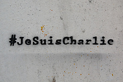 "© Licensed to London News Pictures. 07/01/2016. Paris, France. Grafitti showing the image of 5 cartoonists of the satirical magazine Charlie Hebdo killed during on january 7th 2015 by 2 terrorists which sparked a manhunt that lasted 3 days. A text and image of ""Charb"" Stephane Charbonnier is on the other side of the wall. Today January 3rd 2016. Photo credit: Hugo Michiels/LNP"
