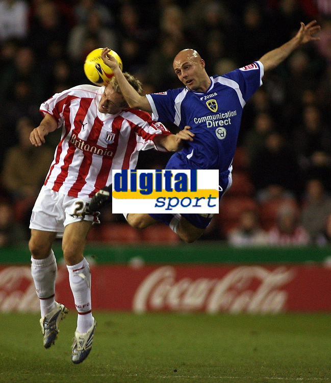 Photo: Paul Thomas.<br /> Stoke City v Cardiff City. Coca Cola Championship. 28/11/2006.<br /> <br /> Liam Lawrence (L) of Stoke and Alan Wright go for the ball.