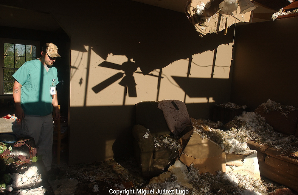 Rainsville, Alabama: In the northeastern corner of Alabama Friday, Richard Lawvir visits the demolished house of his relatives, the Moody family, as President Obama toured Tuscaloosa in the southern part of the state.  (PHOTO: MIGUEL JUAREZ LUGO)