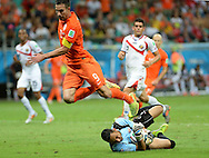 Robin van Persie of Netherlands jumps over the challenge of Keylor Navas of Costa Rica during the 2014 FIFA World Cup match at the Itaipava Arena Fonte Nova, Nazare, Bahia<br /> Picture by Stefano Gnech/Focus Images Ltd +39 333 1641678<br /> 05/07/2014