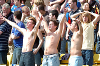 Photo: Tony Oudot.<br />Watford v Portsmouth. The Barclays Premiership. 09/04/2007.<br />Portsmouth fans enjoy the sun with their shirts off