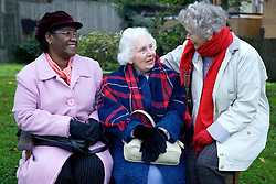Three older women chatting,