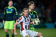 Onderwerp/Subject: Willem II - Ajax - Eredivisie<br /> Reklame:  <br /> Club/Team/Country: <br /> Seizoen/Season: 2012/2013<br /> FOTO/PHOTO: Niek VOSSEBELT (FRONT) of Willem II in duel with Lasse SCHONE (BEHIND) of Ajax. (Photo by PICS UNITED)<br /> <br /> Trefwoorden/Keywords: <br /> #04 #09 $94 ±1342782825903<br /> Photo- & Copyrights © PICS UNITED <br /> P.O. Box 7164 - 5605 BE  EINDHOVEN (THE NETHERLANDS) <br /> Phone +31 (0)40 296 28 00 <br /> Fax +31 (0) 40 248 47 43 <br /> http://www.pics-united.com <br /> e-mail : sales@pics-united.com (If you would like to raise any issues regarding any aspects of products / service of PICS UNITED) or <br /> e-mail : sales@pics-united.com   <br /> <br /> ATTENTIE: <br /> Publicatie ook bij aanbieding door derden is slechts toegestaan na verkregen toestemming van Pics United. <br /> VOLLEDIGE NAAMSVERMELDING IS VERPLICHT! (© PICS UNITED/Naam Fotograaf, zie veld 4 van de bestandsinfo 'credits') <br /> ATTENTION:  <br /> © Pics United. Reproduction/publication of this photo by any parties is only permitted after authorisation is sought and obtained from  PICS UNITED- THE NETHERLANDS