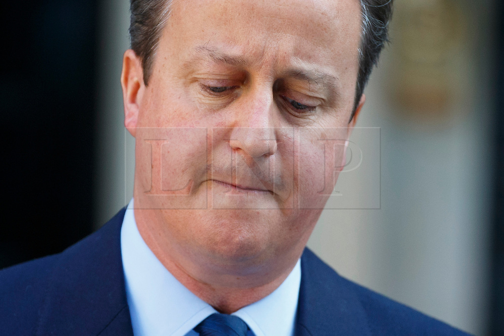 © Licensed to London News Pictures. 24/06/2016. London, UK. Prime Minister DAVID CAMERON announces the EU referendum results and that he will step down as Prime Minister by October in Downing Street, London on Friday, 24 June 2016. The UK has voted by a narrow margin to leave the European Union. Photo credit: Tolga Akmen/LNP