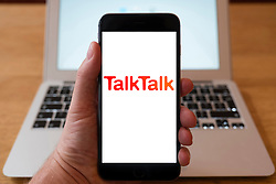 Using iPhone smartphone to display logo of TalkTalk mobile phone and internet provider