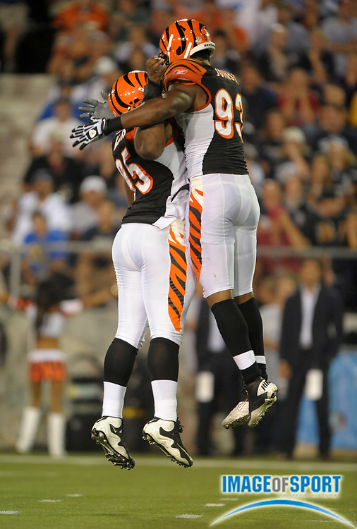 Aug 8, 2010; Canton, OH, USA; Cincinnati Bengals defensive tackle Orien Harris (95), left, and linebacker Michael Johnson (93) bump chests in celebration during the preseason game against the Dallas Cowboys at Fawcett Stadium. The Cowboys defeated the Bengals 16-7. Photo by Image of Sport