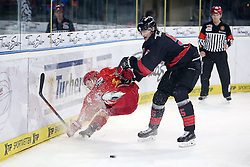 04.01.2015, Arena Nuernberger Versicherung, Nuernberg, GER, DEL, Thomas Sabo Ice Tigers Nuernberg vs Duesseldorfer EG, 35. Runde, im Bild Trikotnr.: 40 Ken Andre Olimb - Duesseldorfer EG (rotes Trikot) vs. Trikotnr.: 55 David Printz - Ice Tigers Nuernberg (schwarzes Trikot) // during Germans DEL Icehockey League 35th round match between Thomas Sabo Ice Tigers Nuernberg and Duesseldorfer EG at the Arena Nuernberger Versicherung in Nuernberg, Germany on 2015/01/04. EXPA Pictures © 2015, PhotoCredit: EXPA/ Eibner-Pressefoto/ Arth<br /> <br /> *****ATTENTION - OUT of GER*****