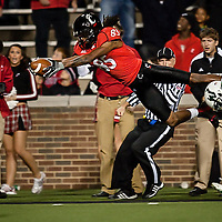 22 October 2010:  Cincinnati wide receiver Marcus Barnett gets big air as he attempts to hurl himself over the goal line after a 69 yard pass reception just before halftime, but Barnett stepped out of bounds at the 4 yard line.  The Bearcats ended up losing tonight 38-30 to the South Florida Bulls at Nippert Stadium in Cincinnati, OH.