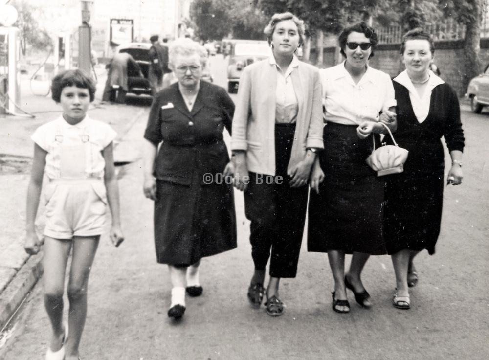 three generations women family strolling France ca 1950s