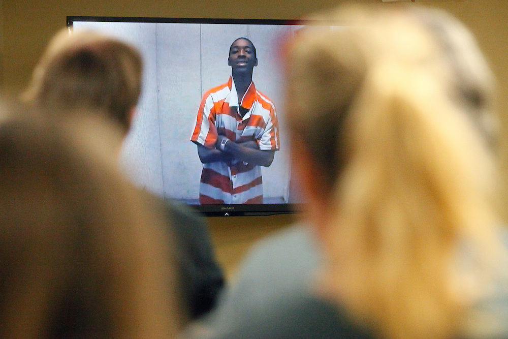 Jahmal Green, suspected of murder in Eric Brantley's shooting, smiles as Brantley's mother, Suzanne Sentner, reads a statement Monday during a bond hearing. (ANDREW KNAPP/STAFF)