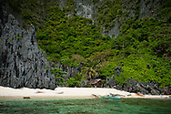 Philippines, Palawan. One of the tiny and beautiful beaches of Bacuit Archipelago, el Nido.