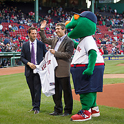 Adam Grossman, Senior Vice President of Marketing and Development for the Red Sox (L) presents a Red Sox jersey to Doctor David Avigan on the field during Fenway Park's Jewish Heritage Night at the game between the Atlanta Braves and the Boston Red Sox at Fenway Park on May 29, 2014 in Boston, Massachusetts. (Photo by Elan Kawesch/Times of Israel)