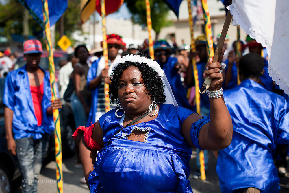 Dominican Republic: The lead Queen waits to lead the procession in the town of Haina as part of the GaGá  procession of El GaGá de San Luis....