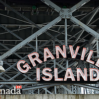Granville Island Sign Below Bridge in Vancouver, Canada<br />