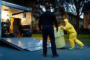 A hazmat crew cleans up hazardous material outside the apartment of Nina Pham who the first confirmed case of Ebola contracted in the United States, in Dallas, Texas on October 12, 2014. Pham, a nurse at Texas Health Presbyterian Hospital, came in contact with Thomas E. Duncan who traveled from Liberia to Dallas to visit his girlfriend and family unknowingly carrying the Ebola virus.