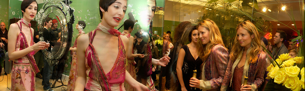 Erin O'Connor and Cat Deeley ( on right) , Matthew Williamson shop opening, 28 Bruton St. 28 April 2004. ONE TIME USE ONLY - DO NOT ARCHIVE  © Copyright Photograph by Dafydd Jones 66 Stockwell Park Rd. London SW9 0DA Tel 020 7733 0108 www.dafjones.com