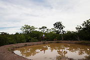 Januaria_MG, Brasil...A fazenda Agroecologica Soma, se intitula uma fazenda produtora de agua. Localiza no municipio de Januaria, a 250 km de Montes Claros, usa a tecnica de Barraginhas ou Bacias de Captacao de Agua de Chuva para recuperar os lencois freaticos e consequentemente os rios da regiao. Em 2005, foram construidas mais de 300 barraginhas na regiao, e acredita-se que o volume de agua dos lencois freaticos cresceu, inclusive com a recuperacao de um rio que corta a propriedade...Na foto, detalhe de uma barraginha na fazenda...The Soma Agroecology farm, is called a farm producing water. Located in the city of Januaria, 250 km from Montes Claros, uses the technique  rainwater catchment to recover the ground water and consequently the rivers of the region. On 2005, they built 300 dam or rainwater catchment in the region, and it is believed that the volume of water of groundwater has grown, including the recovery of a river in the property...In this photo the dam in the farm...Foto: BRUNO MAGALHAES / NITRO