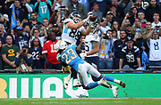 LONDON, ENGLAND - OCTOBER 21: tight end Luke Stocker (88) Of The Titans catches the ball to score a touchdown under the challenge of defensive back Rayshawn Jenkins (23) of The Chargers during the NFL game between Tennessee Titans and Los Angeles Chargers at Wembley Stadium on October 21, 2018 in London, United Kingdom. (Photo by Mitchell Gunn/Pro Lens Photo Agency) *** Local Caption *** Luke Stocker; Rayshawn Jenkins