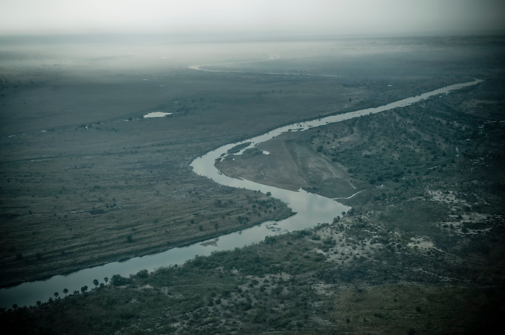 Pictured is an aeriel of a tributary outside the Southern Sudanese town of Aweil, near the northern border. Water remains a big issue in the proposed spilt between North and South Sudan, as control of the Nile River would be retained primarily by the South. (© William B. Plowman)