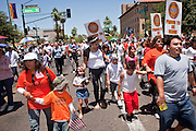 May 29 - PHOENIX, AZ: Pro-immigrant marchers approach the Arizona State Capitol. More than 30,000 people, supporters of immigrants' rights and opposed to Arizona SB1070, marched through central Phoenix to the Arizona State Capitol Saturday. SB1070 makes it an Arizona state crime to be in the US illegally and requires that immigrants carry papers with them at all times and present to law enforcement when asked to. Critics of the law say it will lead to racial profiling, harassment of Hispanics and usurps the federal role in immigration enforcement. Supporters of the law say it merely brings Arizona law into line with existing federal laws.  Photo by Jack Kurtz