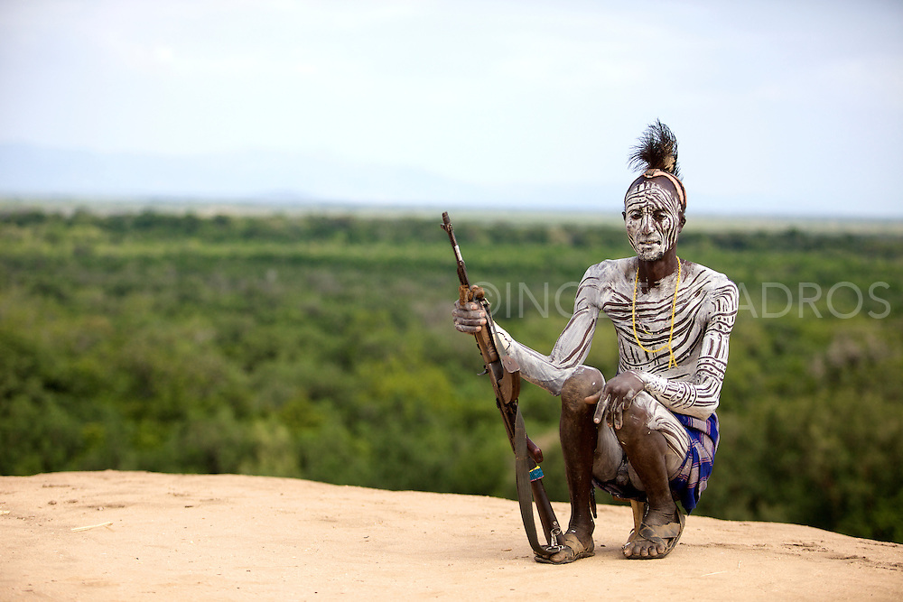 Karo tribe,Omo river 2010 The Karo, which number only about 3,000 people, mainly live on the practice of flood retreat cultivationon the banks of the Omo River in southwestern Ethiopia.The Karo excel in face and body painting, practiced in preparation of their dances and ceremonies, they decorate their bodies, often imitating the spotted plumage of a guinea fowl. Feather plumes are inserted in their clay hair buns to complete the look. The clay hair bun can take up to three days to construct and is usually re-made every three to six months. Their painted facemasks are spectacular. Karo women scarify their chests to beautify themselves. Scars are cut with a knife and ash is rubbed to produce a raised welt.<br />