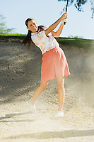 Golfer Pitching Out of Sand Trap