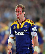 A bloodied Jimmy Cowan leaves the field..Investec Super Rugby - Highlanders v Crusaders, 19 March 2011, Carisbrook Stadium, Dunedin, New Zealand..Photo: Rob Jefferies / www.photosport.co.nz