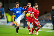 Glenn Middleton (#40) of Rangers FC controls the ball ahead of Dominic Ball (#21) and Shay Logan (#2) of Aberdeen FC during the Ladbrokes Scottish Premiership match between Rangers and Aberdeen at Ibrox, Glasgow, Scotland on 5 December 2018.