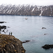 Tone-Jersin Anses and Ole-Kristian Strøm scout for a beach landing on the remote north Iceland Coast