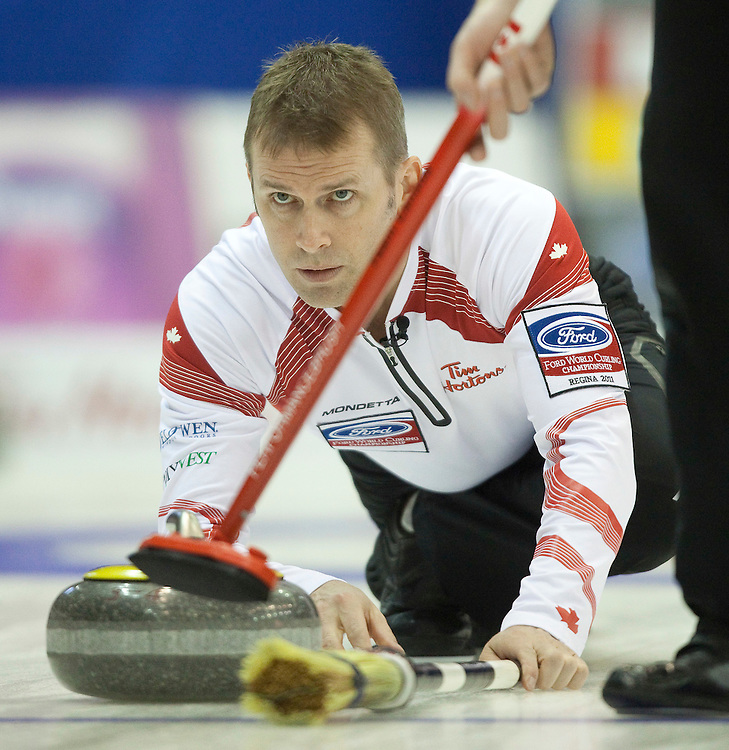 Canada's Skip Jeff Stoughton delivers a shot during his match against Norway in the evening draw at the Ford World Men's Curling Championships at the Brandt Centre in Regina, Saskatchewan, April 7, 2011.<br /> AFP PHOTO/Geoff Robins